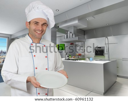 Smiling chef holding an empty plate in a modern kitchen