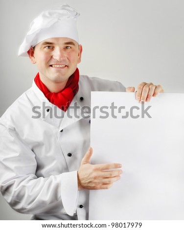 Smiling chef holding menu