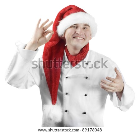 Smiling chef in Santa hat