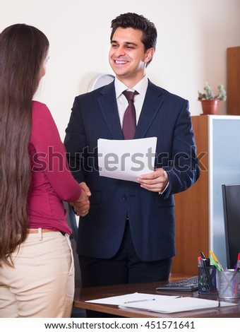 Smiling chief manager hiring female assistant after job interview on permanent basis 
