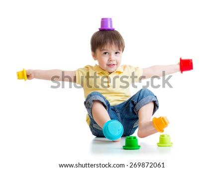 smiling child boy having fun with color toys isolated on white - stock photo