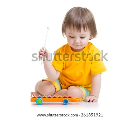 smiling child boy playing with musical toy - stock photo