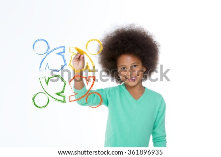 smiling child drawing a team work and looking at the camera - stock photo