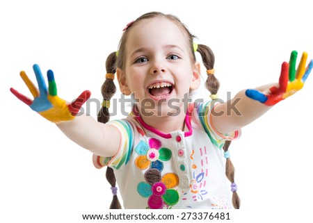 smiling child girl with colorful hands in paints isolated on white