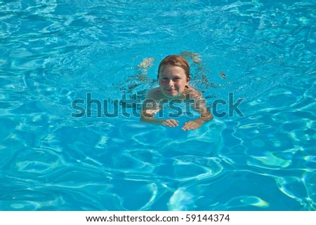 smiling child has fun in the pool