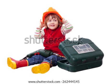 Smiling child in builder hardhat with tools. Isolated over white background   - stock photo