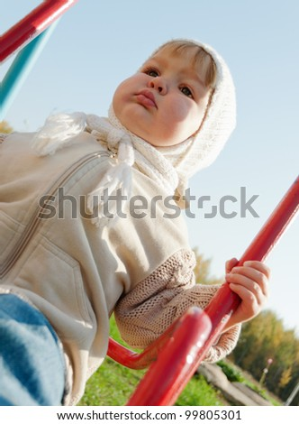 Smiling child on swing in park