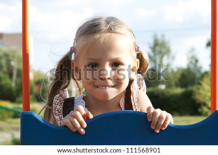 Smiling child on the playground