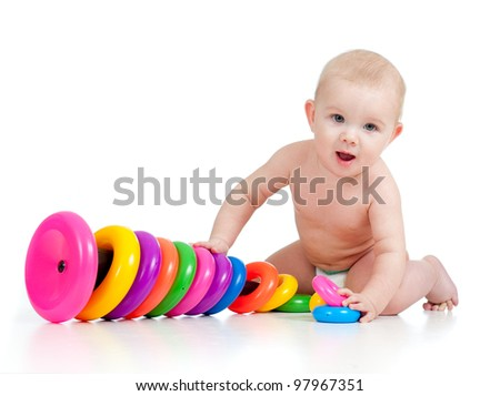 smiling child playing with color toy - stock photo