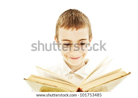 Smiling child reading a book. Isolated on white background. - stock photo