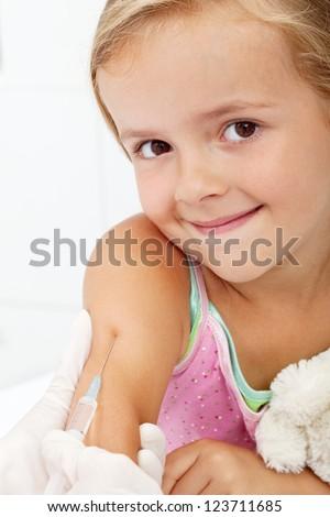 Smiling child receiving vaccine - health care concept, closeup - stock photo