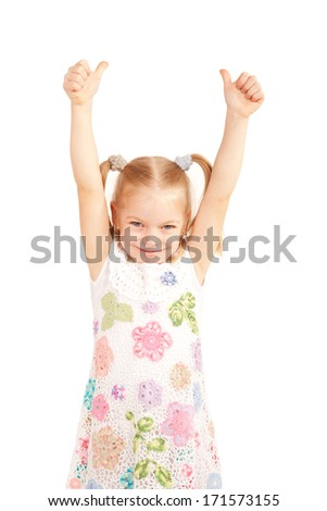 Smiling child showing thumbs up symbol and hands up. Isolated on white background - stock photo