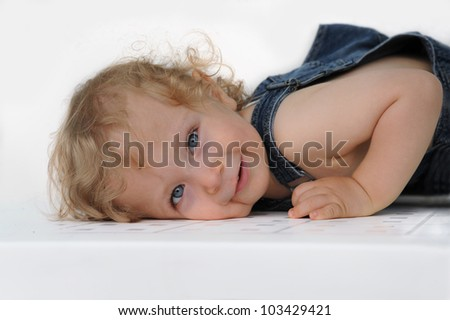 smiling child wearing jeans