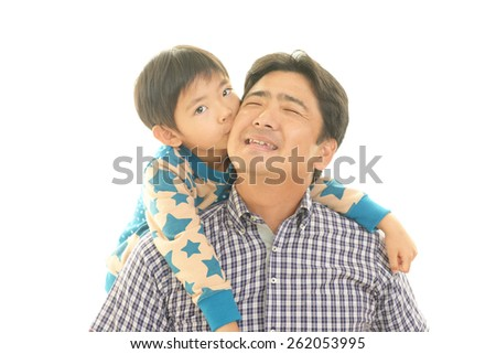 Smiling child with father
