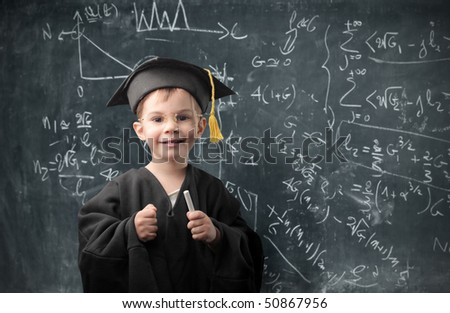 Smiling child with graduate suit - stock photo