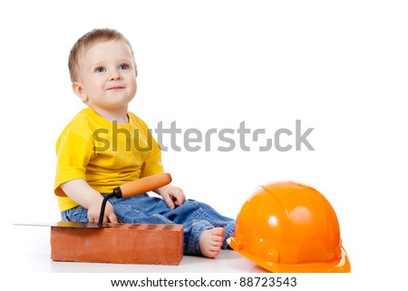 smiling child with hard hat and construction tools - stock photo