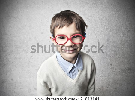 Smiling child with red glasses