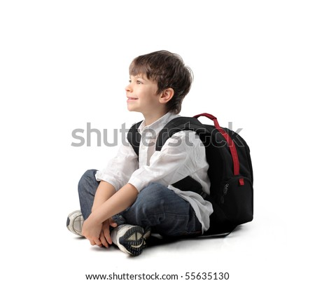 Smiling child with rucksack sitting - stock photo