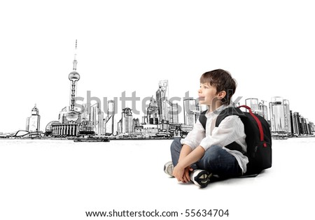 Smiling child with rucksack sitting with cityscape on the background - stock photo