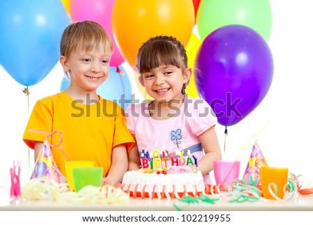 smiling children celebrating birthday party - stock photo