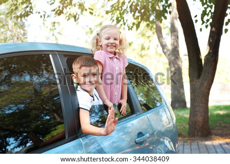 Smiling children in the car