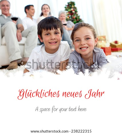 Smiling children looking for presents in Christmas boots against christmas greeting in german - stock photo