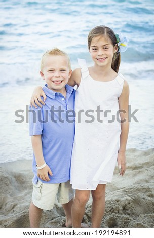Smiling Children portrait at the beach - stock photo
