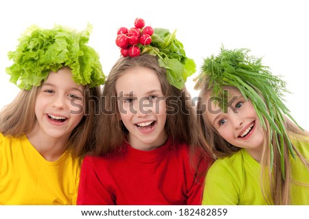 Smiling children with vegetables - stock photo