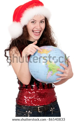 Smiling christmas girl holding globe wearing Santa hat. Isolated on white background. - stock photo