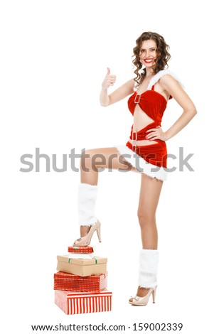 Smiling christmas woman with thumb up