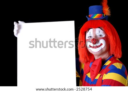 Smiling Clown Holding a Blank Sign - stock photo
