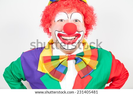 smiling clown on white background - stock photo