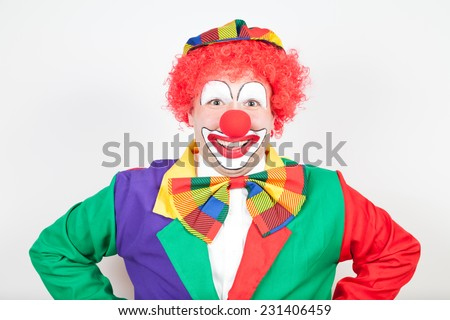smiling clown on white backtground - stock photo