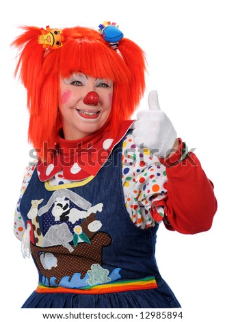 Smiling clown with orange hair showing approval - stock photo