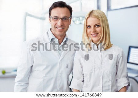 Smiling colleagues in a laboratory - stock photo