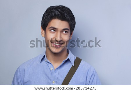 Smiling college student looking up - stock photo