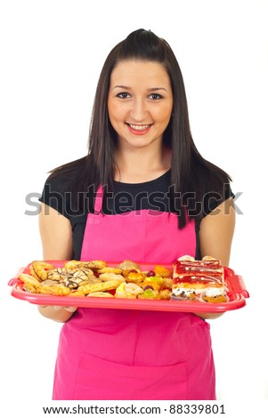 smiling confectioner woman with pink apron holding different cakes on plateau and offering for sale isolated on white background - stock photo