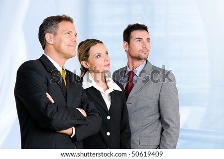 Smiling confident business team looking away at their bright future - stock photo