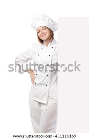 smiling confident female chef, cook or baker hiding behind banner with empty copy space for you text isolated on white background. advertisement blank board. your text here