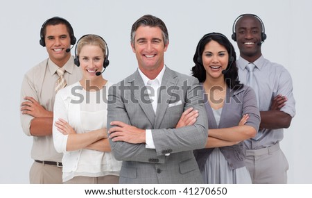 Smiling confident multi-ethnic team working in a call center