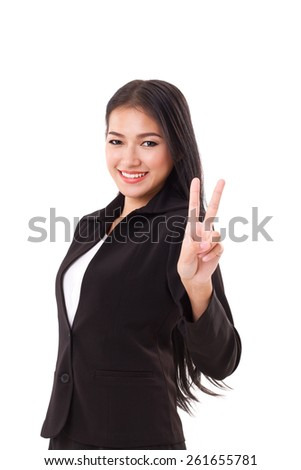 smiling, confident, successful business woman executive showing v sign 2 fingers gesture, concept of leader, winner, victory - stock photo