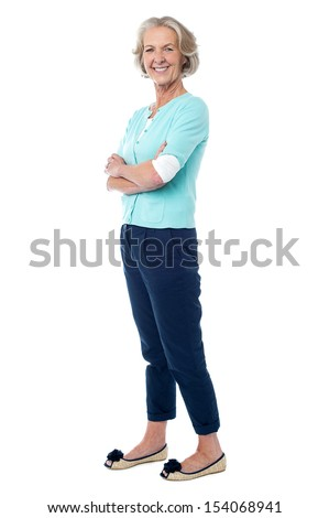 Smiling confident woman posing with arms crossed - stock photo