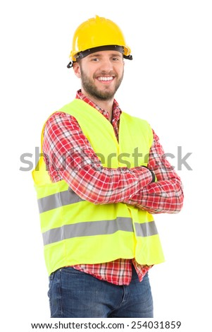 Smiling construction worker in yellow helmet and lime waistcoat posing with arms crossed. Three quarter length studio shot isolated on white. - stock photo