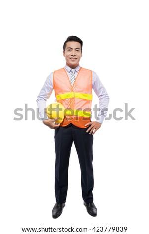 Smiling construction worker in yellow helmet and orange waistcoat. Waist up studio shot isolated on white. - stock photo