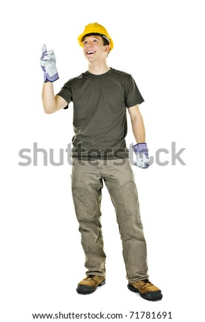 Smiling construction worker pointing up standing isolated on white background - stock photo