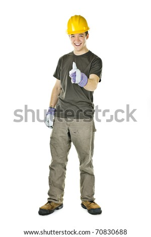 Smiling construction worker showing thumbs up isolated on white background - stock photo