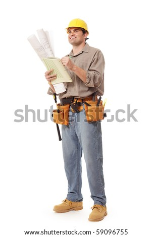 Smiling construction worker writing notes - stock photo