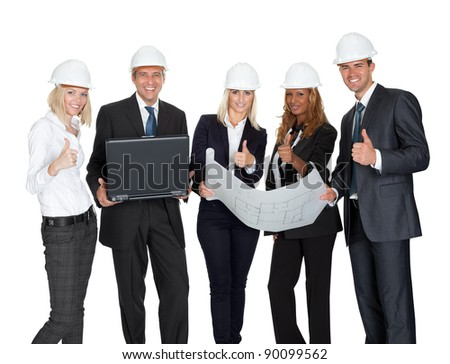 Smiling construction workers with laptop and blueprint showing thumbs sign