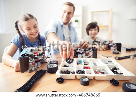 smiling content  father playing with kids  - stock photo