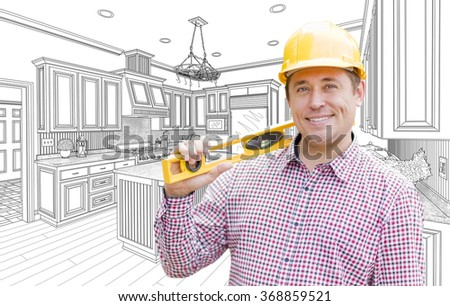 Smiling Contractor in Hard Hat with Level Over Custom Kitchen Drawing. - stock photo